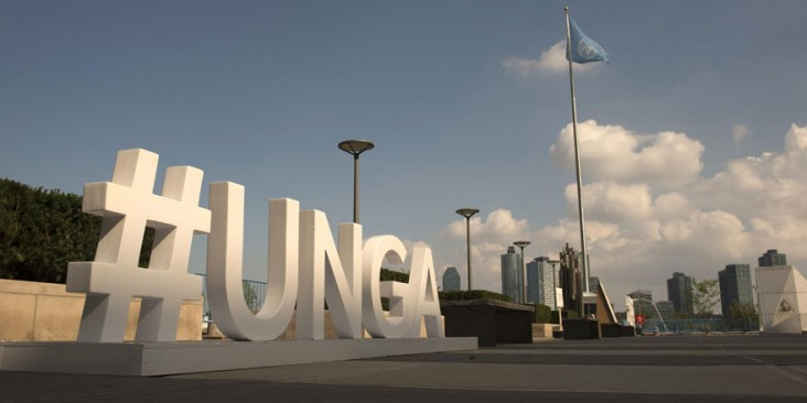 Large sign saying #UNGA with the United Nations flag in the background