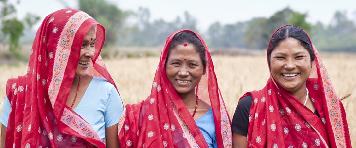 Close up of three women smiling in a field