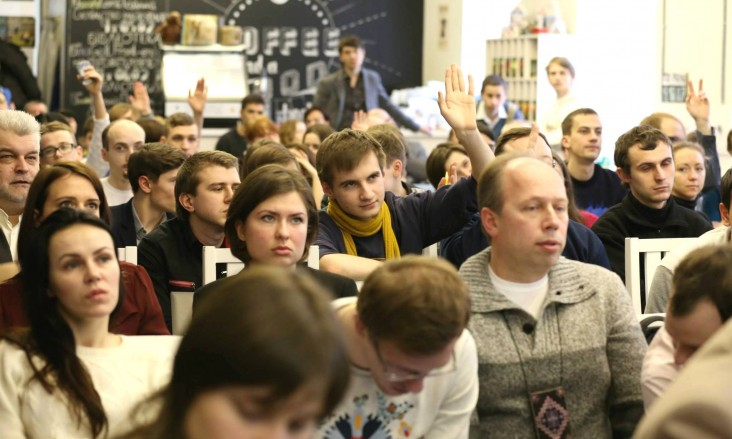 The audience poses questions to the teams as they present their prototypes at a hackathon in Ukraine in February 2015.