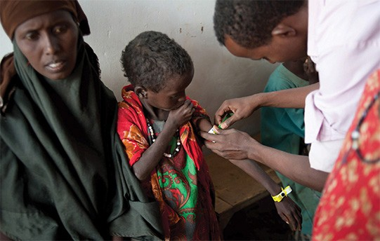 A Somali boy is checked for malnutrition at a refugee camp in Kenya. Somalia, which has endured 20 years of conflict, descended