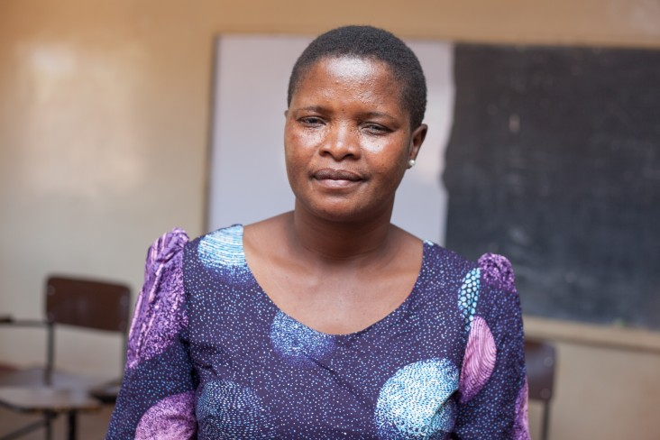 "As senior group village head in Mponela, Chifuniro Ndelemani sees her role as ""looking after people."" She is grateful to WRA as both a chief and a woman."