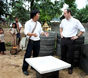 WaterSHED entrepreneur, Aun Hengly (left), leads the way for new WASH partnerships, and here consults with USAID sanitation Tech