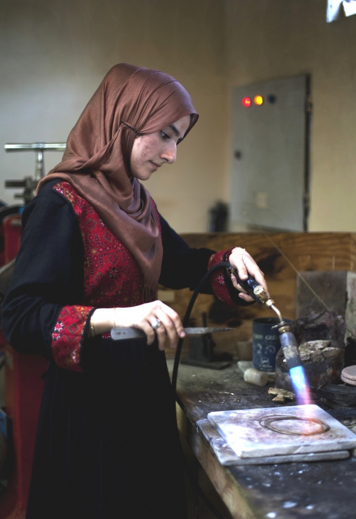 Storai Stanizai, a third-year jewelry student, works on a piece celebrating Ghazni as the 2013 City of Islamic Culture.