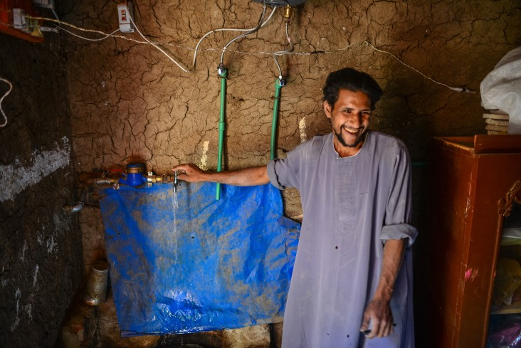 Villager at water faucet