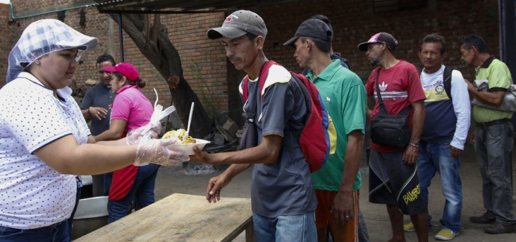 "Venezuelans get food at the Casa de Paso Divina Providencia refuge in Cucuta, Colombia on July 31, 2017. The United States, Mexico, Colombia, Peru and other nations said they did not recognize the results of the election Sunday of a new ""Constituent Assembly"" superseding Venezuela's legislative body, the opposition-controlled National Assembly."