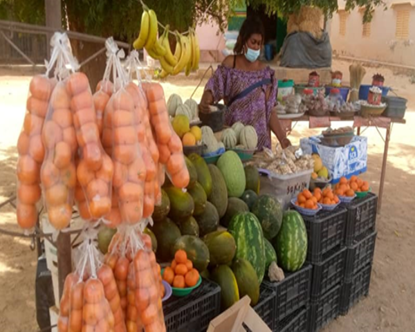 A beneficiary of Suxali Jigeen's micro-finance program managing her produce stand.