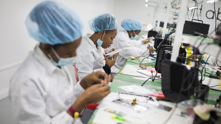 Employees assemble tablets at the Surtab factory in Port-au-Prince, Haiti