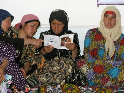 Female farmers in Tajikistan share information on how to start their own farms. USAID helped more than 700 women establish their