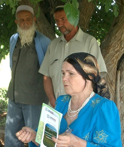 Rural Women Legal Aid Center Director Mukarrama Egamnazarova provides training on land-use rights to Khatlon, Tajikistan, farmer