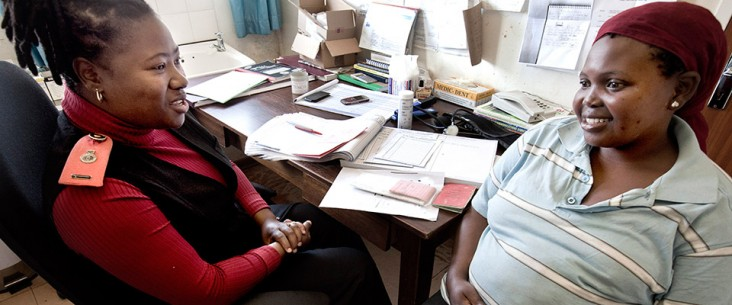 Lungile, an HIV-positive mother-to-be, receives counseling from a health care worker at a clinic in Swaziland.