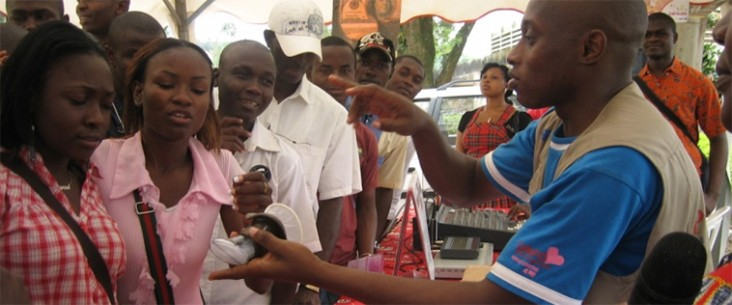An educator demonstrates female condoms with students from the University of Yaoundé, Cameroun.