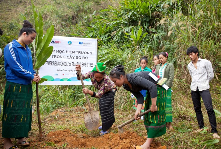 Local farmers attend a USAID-supported training on how to plant bo bo trees in the central province of Nghe An.