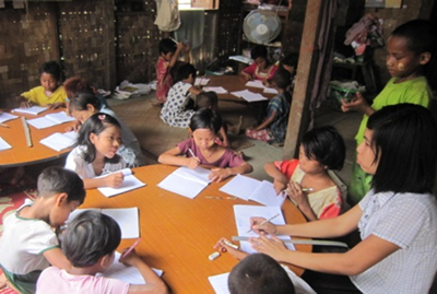 Image of children at a community learning center in Burma.