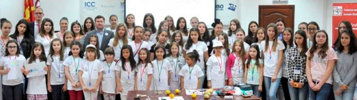 Girls and their parents pose for a group photo at EVN Macedonia's Bring Your Daughter to Work Day in Skopje