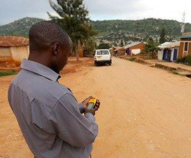 photo of a man using a cell phone for GIS mapping