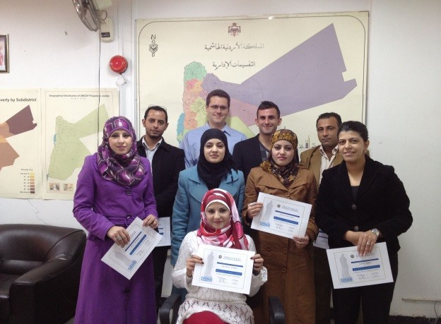 """DOS staff members after receiving a completion certification for """"Introduction to GIS"""" training course"""
