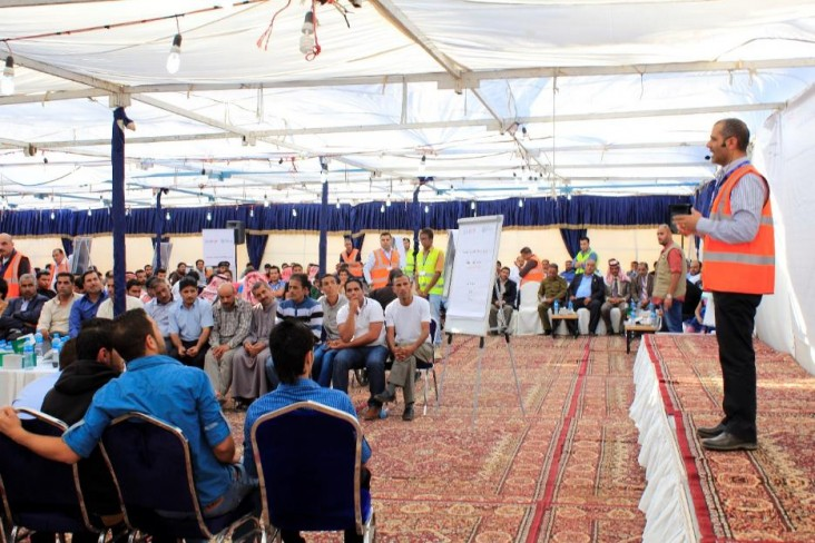 Um Al Jamal community members participating in a community-wide meeting in the Governorate of Mafraq.