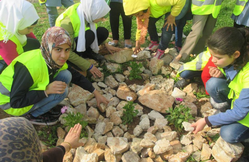 Yarmouk students participate in school beautification activities facilitated by the CET.