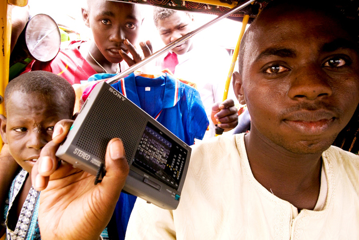 A minicab driver listens to a radio broadcast in a market in Abeche, Chad (2009)