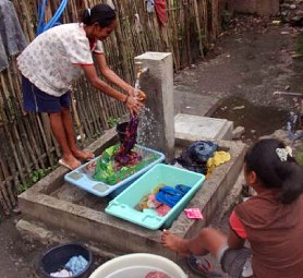 Woman Using DWASH Water Supply Facility, Laclubar, Manatuto District, Timor-Leste.