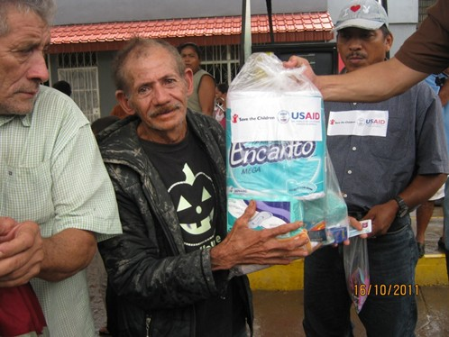 USAID/OFDA distributes emergency relief supplies following flooding and landslides in El Salvador in October 2011.