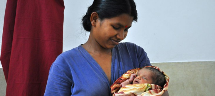 A health worker holds an infant