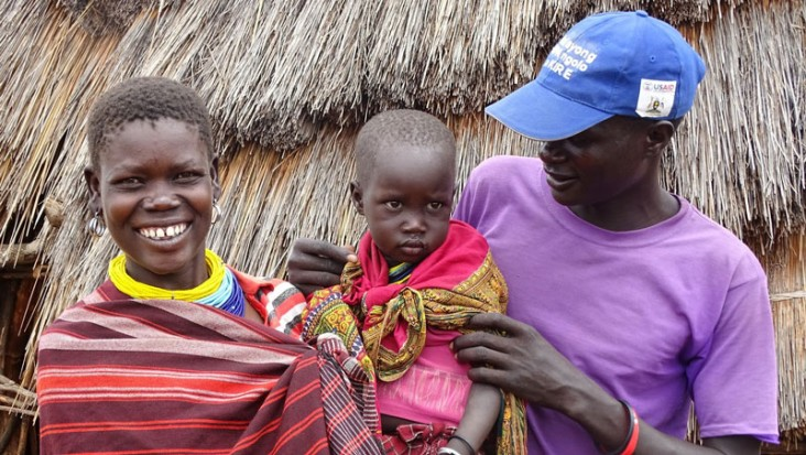 A small family in Uganda - father, mother and baby.