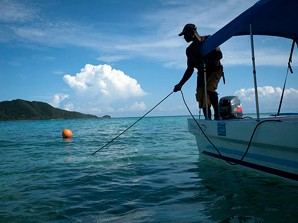 Local fisherman,  Victor Cordova, anchors his boat in the Cayos Cochinos Islands