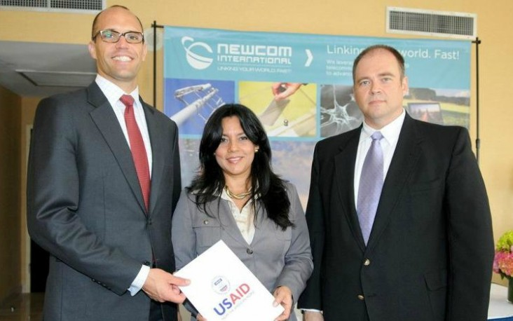 Deputy Assistant Administrator for Latin America and the Caribbean Mark Lopes and officials from NewCom.