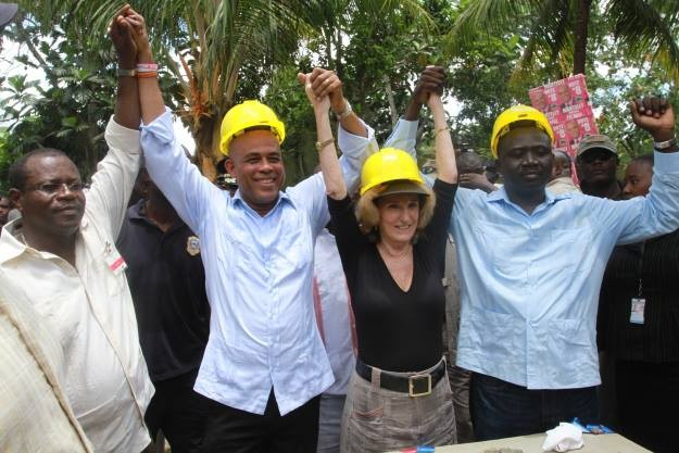 Haitian President Michel Martelly and U.S. Ambassador to Haiti Pam White and other Haitian government officials at the launch.