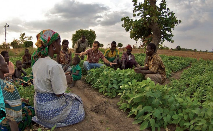 A Peace Corps volunteer trains his local community in Malawi on the nutritional benefits  of growing soy.