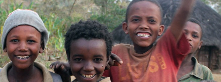 Four boys smile at the camera