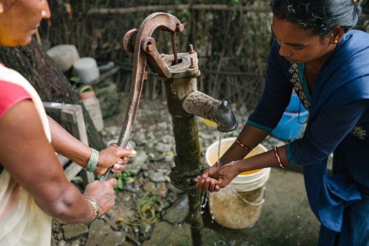 Bimala Chaudhary practices proper hand washing before preparing a meal for her 10-month-old daughter.