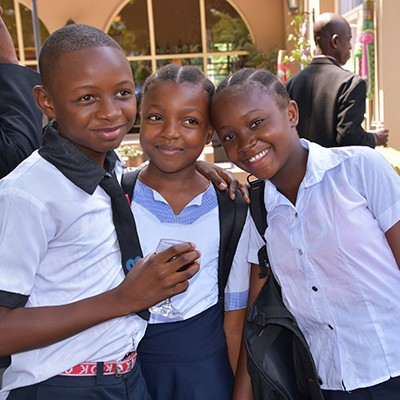 Classmates in the Democratic Republic of Congo celebrate their success after a performance at an event organized to celebrate the International Day of the Girl Child.