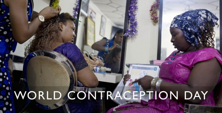A woman gets her hair braided while another woman discusses family planning options.