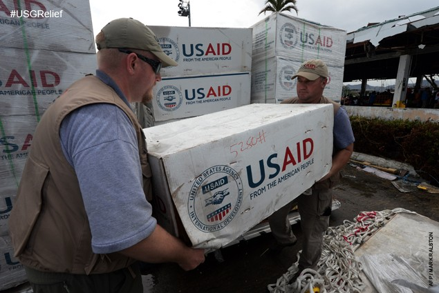 USAID staff prepare to load relief supplies into a US navy Seahawk helicopter at Tacloban Airport on November 17, 2013.