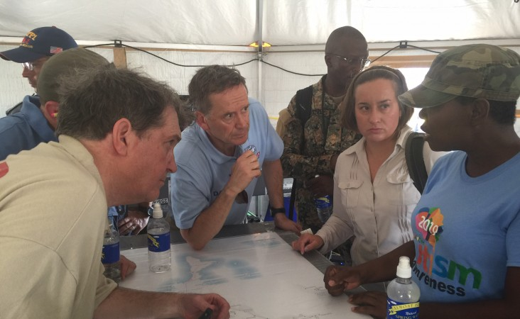Administrator Green is briefed by USAID's Urban Search and Rescue team after landing in Abaco.