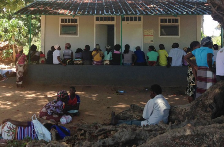 Patients wait to be seen outside of a health facility in Mozambique's Inhambane Province.