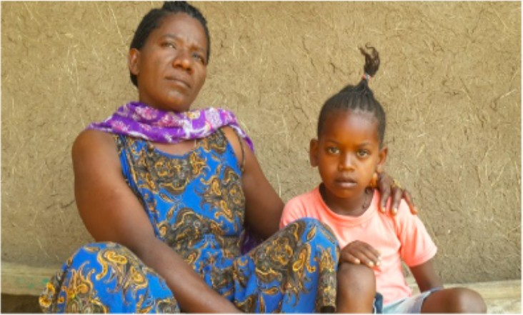 Aynete Afa and daughter Mignot Abebe, both enrolled in USAID's OVC programs sitting by their home in Arbaminch town of SNNPR, Ethiopia