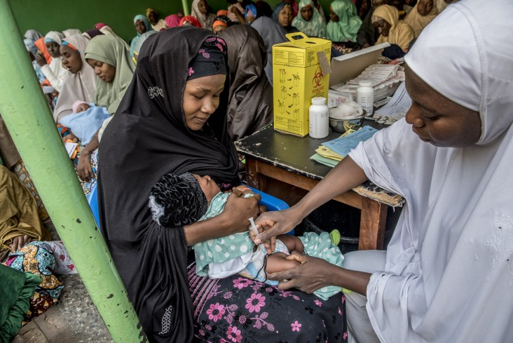 A vaccine is administered to an infant