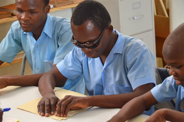 A Haitian boy learns to read in Braille at the St. Vincent School for Handicapped Children in Port-au-Prince, Haiti.