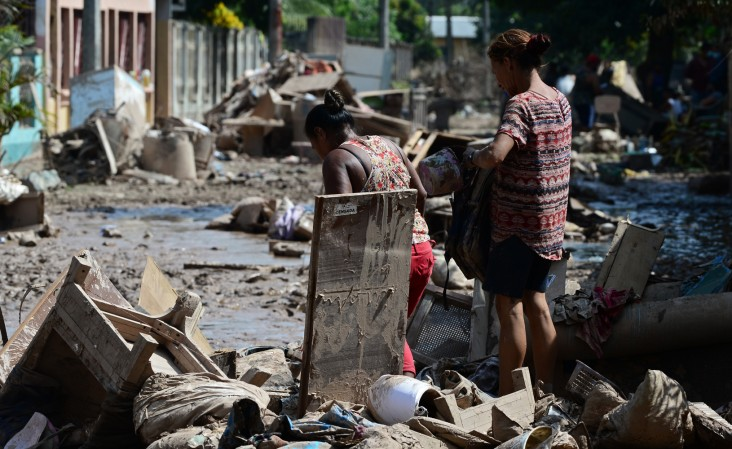 Women try to recover belongings after the passage of Hurricane Eta at the Omonita neighborhood in El Progreso, Yoro department, Honduras, On November 15 2020, before the arrival of Hurricane Iota.