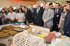 group of people at a trade show in Iraq