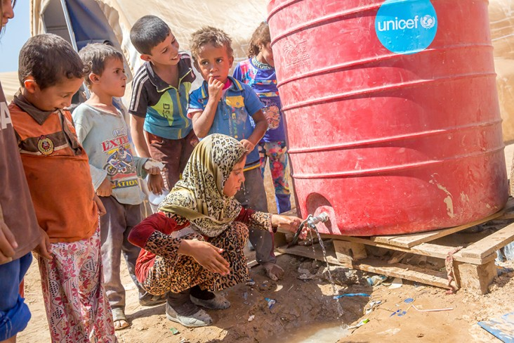 Iraq disaster assistance us agency for international development fatima 10 washes her face at a water tank provided by unicef in tinah camp on september 5 2016 usaid has been supporting unicef to provide safe drinking publicscrutiny Gallery