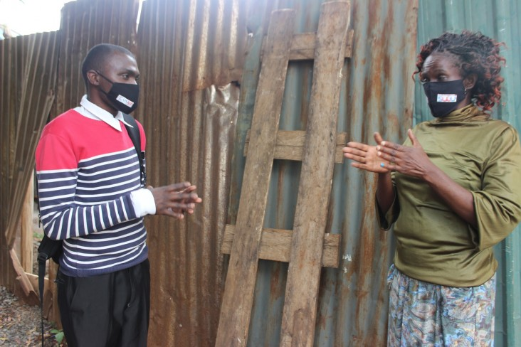 Steve during a home visit to one of the many TB/HIV patients he supports in Nairobi. TB/HIV champions like Steve learn to create awareness in their communities, support patients' understanding of treatment, and conduct peer-to-peer learning sessions.