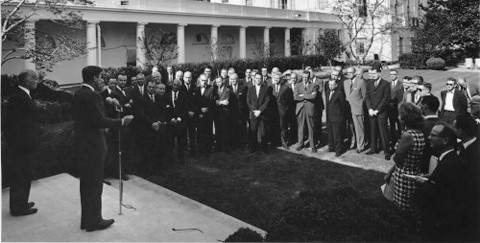 President Kennedy addresses a group of USAID Mission Directors and Deputy Mission Directors in the White House Rose Garden in Wa