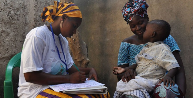 A community health worker examines a patient in Kita, Mali