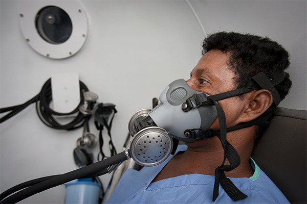 Selin Taylor Wood breathes through a mask in the hyperbaric chamber after suffering an embolism while diving at 86 feet.