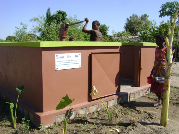 Beneficiary using water tap provided by USAID-funded JSI/Mahefa project