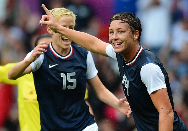 US forward Abby Wambach (R) celebrates after scoring during the London 2012 Olympic Games. Photo: Andrew Yates, AFP